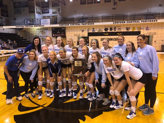 The Memorial volleyball team poses with the regional championship trophy after last weekend's sweep over Silver Creek.