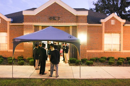 Potential pledges outside of the Phi Kappa Tau house in Heritage Grove during rush activities on Sep. 6.