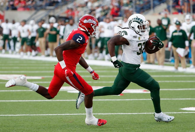 Colorado State running back Marcus McElroy runs past Fresno State's Chris Gaston for a touchdown during the first half of an NCAA college football game in Fresno, Calif., Saturday, Oct. 26 2019.