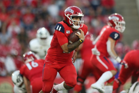 Oct 26, 2019; Fresno, CA, USA; Fresno State Bulldogs quarterback Jorge Reyna (11) runs the ball against the Colorado State Rams in the second quarter at Bulldog Stadium. Mandatory Credit: Cary Edmondson-USA TODAY Sports