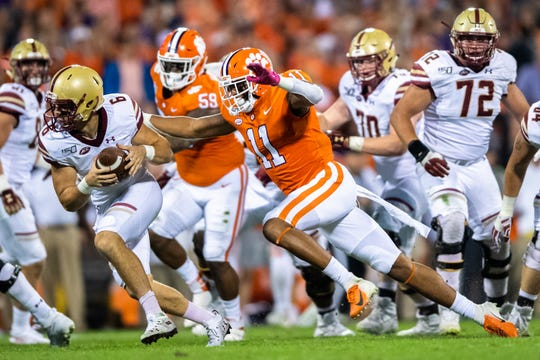 Boston College quarterback Dennis Grosel looks to get rid of the ball as Clemson safety Isaiah Simmons (11) closes in on a sack during their game at Memorial Stadium with Boston College in Clemson, South Carolina Saturday, October 26, 2019.