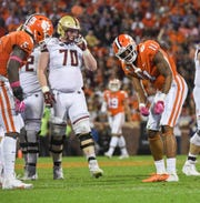 Clemson safety Isaiah Simmons (11) celebrates with a putt-putt pose after sacking Boston College quarterback Dennis Grosel during the second quarter at Memorial Stadium with Boston College in Clemson, South Carolina Saturday, October 26, 2019.