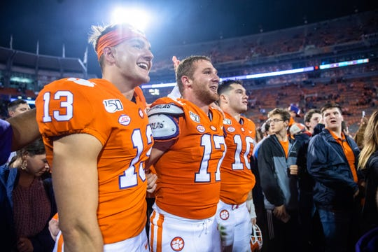 Clemson wide receiver Brannon Spector(13), Clemson linebacker Kane Patterson (17), and Clemson linebacker Baylon Spector (10) stand arm in arm singing their alma mater after the game at Memorial Stadium with Boston College in Clemson, South Carolina Saturday, October 26, 2019.