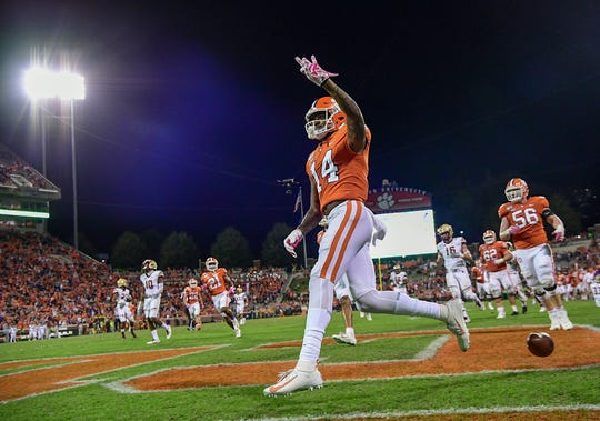 Clemson wide receiver Diondre Overton (14) holds up three fingers scoring his third touchdown of the game during the fourth quarter at Memorial Stadium with Boston College in Clemson, South Carolina Saturday, October 26, 2019.