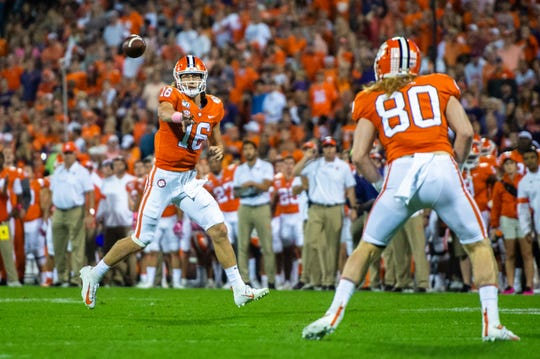Clemson quarterback Trevor Lawrence (16) throws a pass to Clemson tight end Luke Price (80) during their game at Memorial Stadium with Boston College in Clemson, South Carolina Saturday, October 26, 2019.