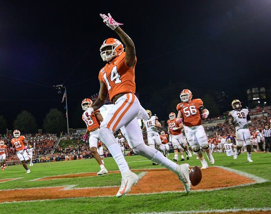 Clemson wide receiver Diondre Overton (14) holds up three fingers after scoring his third touchdown of the game during the fourth quarter against Boston College Saturday, October 26, 2019.