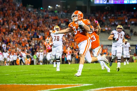 Clemson defensive end Logan Rudolph (34) runs the ball in for a touchdown after recovering a fumble during the third quarter at Memorial Stadium with Boston College in Clemson, South Carolina Saturday, October 26, 2019.