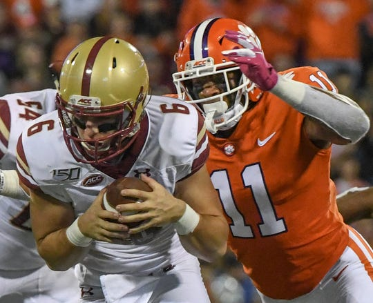 Clemson safety Isaiah Simmons (11) sacks Boston College quarterback Dennis Grosel during the second quarter at Memorial Stadium with Boston College in Clemson, South Carolina Saturday, October 26, 2019.