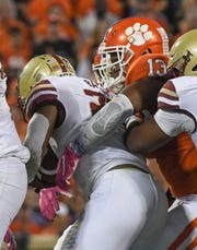Clemson defensive lineman Tyler Davis(13) tackles Boston College running back David Bailey during the second quarter at Memorial Stadium with Boston College in Clemson, South Carolina Saturday, October 26, 2019.
