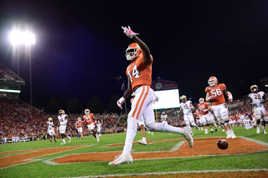Clemson wide receiver Diondre Overton (14) holds up three fingers — one finger for each touchdown he scored against Boston College on Saturday, Oct. 26, 2019.