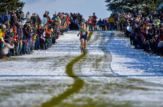 Glacier's Simon Hill holds off Hellgate's Ian Curtis  to win boys' Class AA race during the state cross country meet at Eagle Falls Golf Course in Great Falls, Saturday, October 26, 2019.