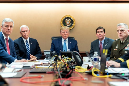 In this image released by the White House, President Donald Trump is joined Saturday by Vice President Mike Pence, second from left, national security adviser Robert O'Brien, left; Secretary of Defense Mark Esper, second from right,  and Chairman of the Joint Chiefs of Staff Army Gen. Mark A. Milley, right.