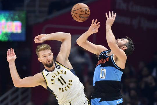 Indiana Pacers forward Domantas Sabonis (11) fouls Cleveland Cavaliers forward Kevin Love (0) during the first quarter at Rocket Mortgage FieldHouse.