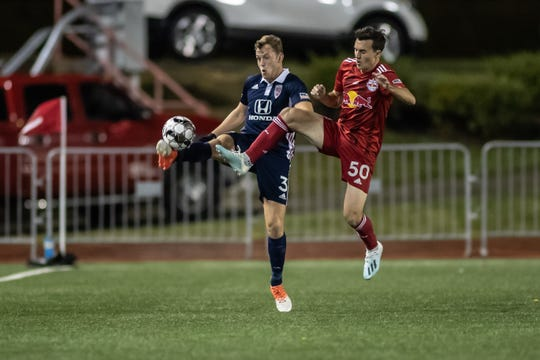 Indy Eleven defender Macauley King clears the ball from pressure in Indy's USL playoff win over NY Red Bulls II on Saturday at Carroll Stadium.