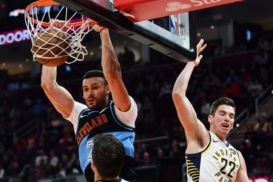 Oct 26, 2019; Cleveland, OH, USA; Cleveland Cavaliers forward Larry Nance Jr. (22) dunks as Indiana Pacers forward T.J. Leaf (22) defends during the second half at Rocket Mortgage FieldHouse. Mandatory Credit: Ken Blaze-USA TODAY Sports