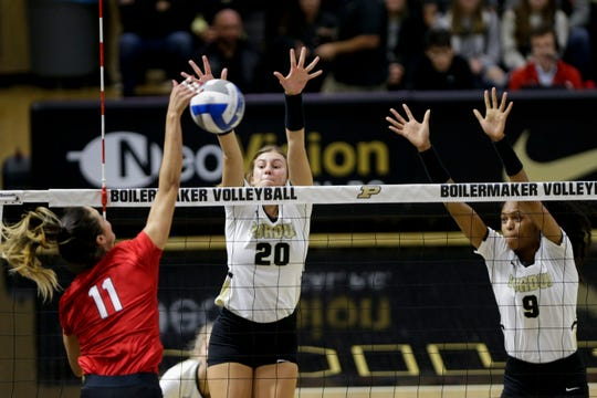 Purdue middle blocker Grace Cleveland (20) and Purdue middle blocker Shavona Cuttino (9) go up to block as Nebraska outside hitter Lexi Sun (11) spikes the ball during the first set of an NCAA women's volleyball game, Saturday, Oct. 26, 2019 at Holloway Gymnasium in West Lafayette.