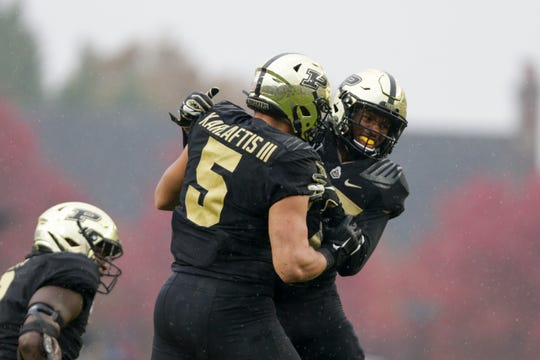 Purdue safety Navon Mosley (27) celebrates a sack by Purdue defensive end George Karlaftis (5) during the first quarter of a NCAA football game, Saturday, Oct. 26, 2019 at Ross-Ade Stadium in West Lafayette.