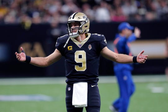 New Orleans Saints quarterback Drew Brees (9) reacts in the first half of an NFL football game against the Arizona Cardinals in New Orleans, Sunday, Oct. 27, 2019. (AP Photo/Bill Feig)