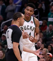Giannis Antetokounmpo argues with a referee Jonathan Sterling, who whistled the Bucks star with his sixth and final foul of the game against the Heat in overtime.