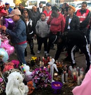 Candles are lit at a vigil for Lisa Gee, a 6-year-old girl struck and killed by a hit-and-run driver who ran a red light at North 22nd and West Center streets in Milwaukee on Oct. 24.