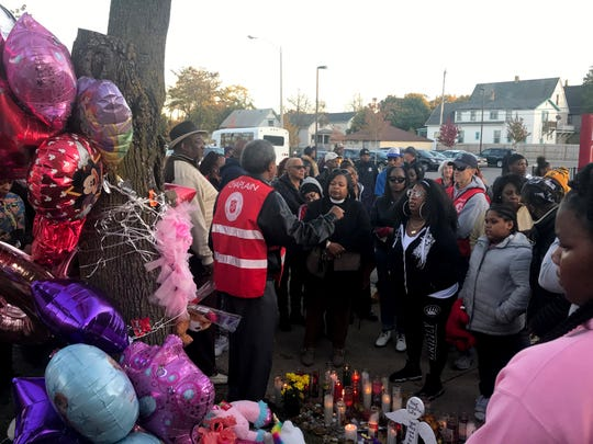 A Salvation Army chaplain speaks to a crowd at a vigil Sunday evening for 6-year-old Lisa Gee who was killed by a hit-and-run driver as she walked in the crosswalk at North 22nd and West Center streets. Her 4-year-old sister and 10-year-old cousin were seriously injured.