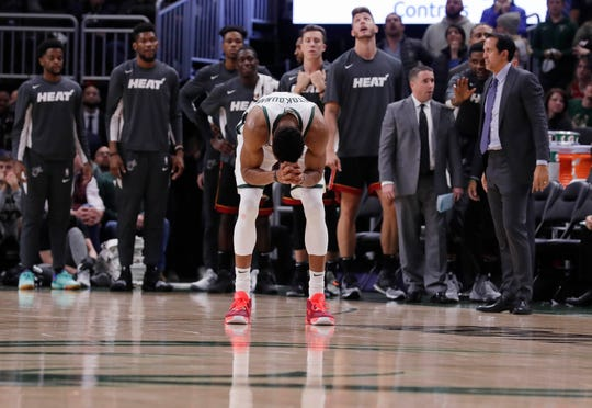 Bucks forward Giannis Antetokounmpo reacts after fouling out in overtime against the Heat.