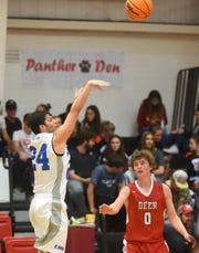 Cotter's Dylan Dwyer launches a 3-pointer against Deer on Saturday night.