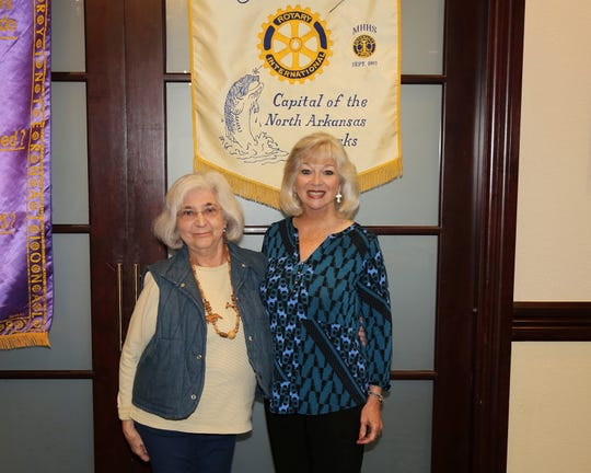 Marlena Holland, who has lived with polio for more than 70 years, was the guest speaker at the civic group's weekly meeting at Big Creek Golf & Country Club. Holland (left) is pictured with Mountain Home Rotarian Brenda Nelson