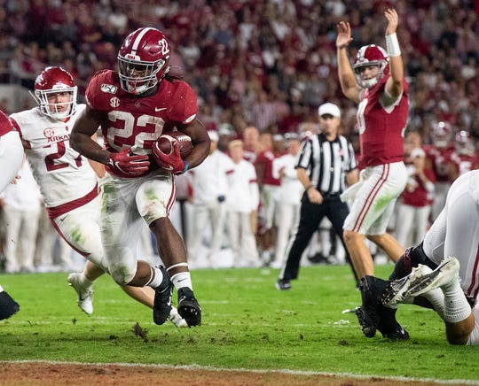 Alabama running back Najee Harris (22) scores a touchdown against Arkansas at Bryant-Denny Stadium in Tuscaloosa, Ala., on Saturday October 26, 2019.