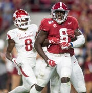 Alabama linebacker Christian Harris (8) celebrates his fumble recovery at Bryant-Denny Stadium in Tuscaloosa, Ala., on Saturday October 26, 2019.