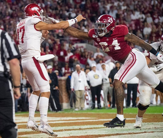 Alabama linebacker Terrell Lewis (24) pressures Arkansas quarterback Nick Starkel (17) as he releases a pass in the end zone at Bryant-Denny Stadium in Tuscaloosa, Ala., on Saturday October 26, 2019.