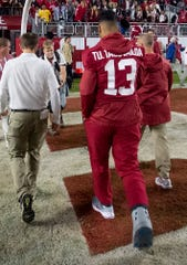 Alabama quarterback Tua Tagovailoa (13) walks of the field in a boot after Alabama defeated Arkansas at Bryant-Denny Stadium in Tuscaloosa, Ala., on Saturday October 26, 2019.