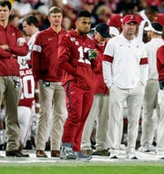 Oct 26, 2019; Tuscaloosa, AL, USA; Alabama Crimson Tide quarterback Tua Tagovailoa (13) watches from the sideline during the second half of an NCAA college football game against the Arkansas Razorbacks at Bryant-Denny Stadium. Mandatory Credit: Butch Dill-USA TODAY Sports
