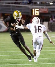 ASU wide receiver Michael Jefferson (19) tries to avoid a tackle by Alabama A&M defensive back Tuwile Wilson  (16).