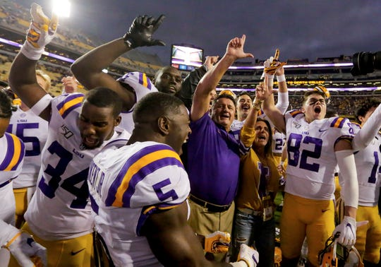 Oct 26, 2019; Baton Rouge, LA, USA; LSU Tigers head coach Ed Orgeron celebrates with players after defeating the Auburn Tigers 23-20 at Tiger Stadium. Mandatory Credit: Derick E. Hingle-USA TODAY Sports