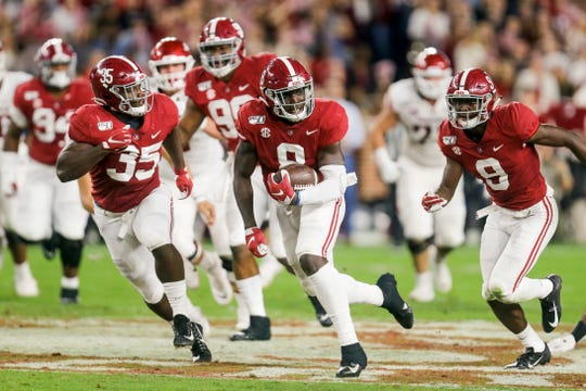Oct 26, 2019; Tuscaloosa, AL, USA; Alabama Crimson Tide linebacker Christian Harris (8) runs after recovering a fumble during the first half of an NCAA college football game against the Arkansas Razorbacks at Bryant-Denny Stadium. Mandatory Credit: Butch Dill-USA TODAY Sports
