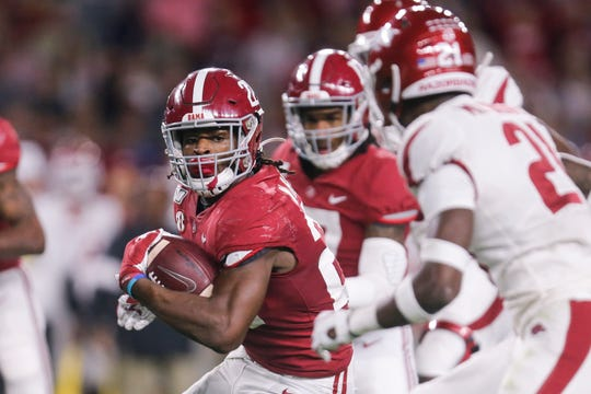 Oct 26, 2019; Tuscaloosa, AL, USA; Alabama Crimson Tide running back Najee Harris (22) carries the ball during the first half of an NCAA college football game against the Arkansas Razorbacks at Bryant-Denny Stadium. Mandatory Credit: Butch Dill-USA TODAY Sports