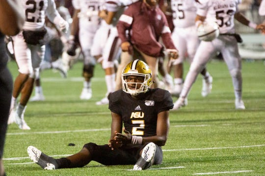 ASU quarterback KHA'Darrius Davis (12) looks dejected after an incomplete pass lost the Hornets the game against Alabama A&M.