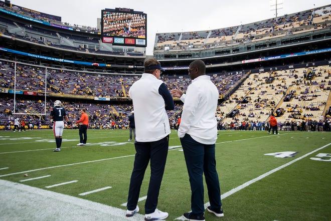 Auburn head coach Gus Malzahn and athletic director Allen Greene talk before the game at Tiger Stadium in Baton Rouge, La., on Saturday, Oct. 26, 2019. LSU defeated Auburn 23-20.