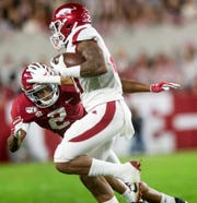 Alabama defensive back Patrick Surtain, II, (2) stops Arkansas running back Devwah Whaley (21) at Bryant-Denny Stadium in Tuscaloosa, Ala., on Saturday October 26, 2019.