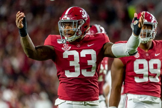 Alabama linebacker Anfernee Jennings (33) cheers the crowd against Arkansas during the first half of an NCAA college football game, Saturday, Oct. 26, 2019, in Tuscaloosa, Ala. (AP Photo/Vasha Hunt)