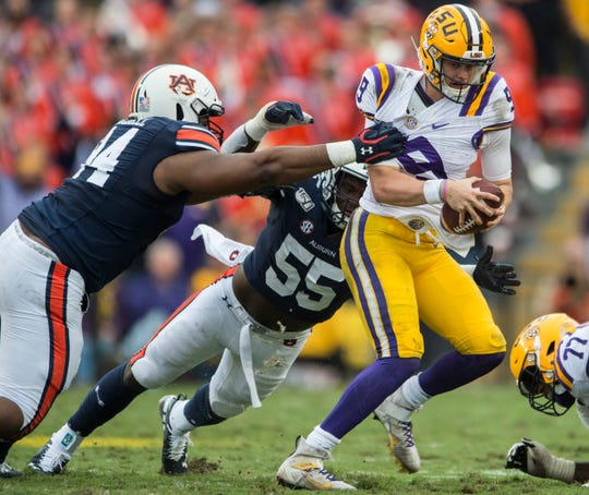 LSU quarterback Joe Burrow (9) is sacked by Auburn defensive lineman Tyrone Truesdell (94) at Tiger Stadium in Baton Rouge, La., on Saturday, Oct. 26, 2019. LSU defeated Auburn 23-20.