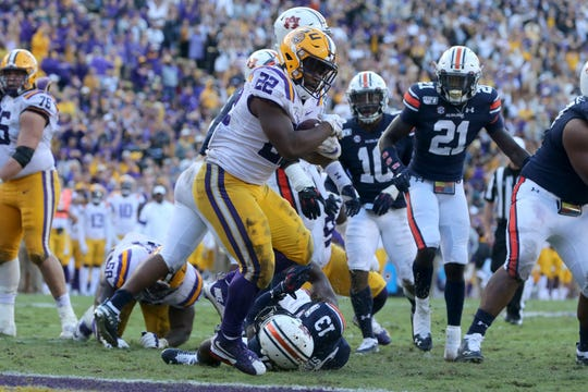 Oct 26, 2019; Baton Rouge, LA, USA; LSU Tigers running back Clyde Edwards-Helaire (22) scores a touchdown on a run run in the third quarter against the Auburn Tigers at Tiger Stadium. Mandatory Credit: Chuck Cook-USA TODAY Sports
