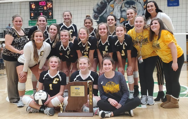 Cowan poses for pictures following its regional championship victory over Blue River Valley at Clinton Central High School Saturday, Oct. 26, 2019.