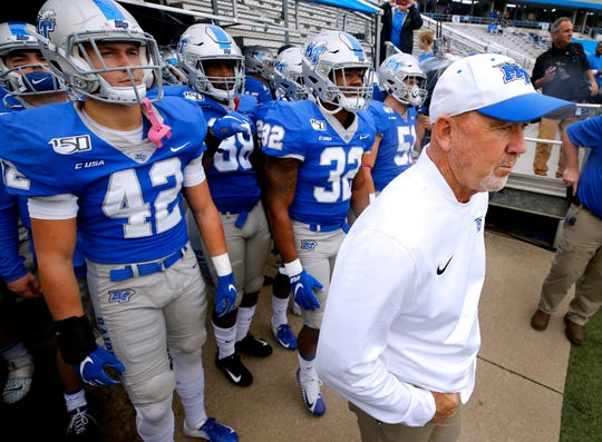 MTSU head coach Rick Stockstill stands with the team before they take the field for the Homecoming game against FIU on Saturday, Oct. 26, 2019, at MTSU.