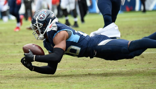 Titans cornerback Logan Ryan pulls in a catch that was initially ruled an interception during the second quarter Sunday, but was later overturned. Ryan later picked off Jameis Winston to help put the game away in the Titans' 27-23 win.