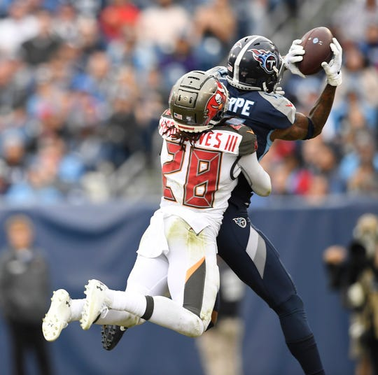 Tennessee Titans wide receiver Tajae Sharpe pulls down a first-down catch as Tampa Bay Buccaneers cornerback Vernon Hargreaves defends in the fourth quarter Sunday. The conversion kept Tennessee's drive alive, which ended in A.J. Brown's TD catch to put the Titans ahead.
