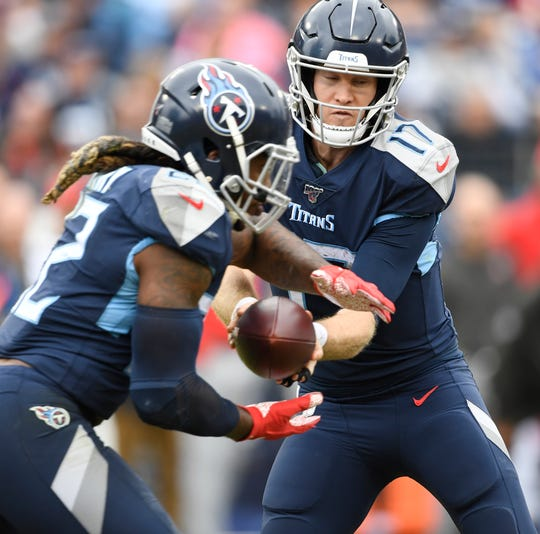 Tennessee Titans quarterback Ryan Tannehill (17) hands off to running back Derrick Henry (22) during the third quarter at Nissan Stadium Sunday, Oct. 27, 2019 in Nashville, Tenn.