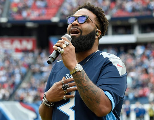 Blanco Brown performs the national anthem at Nissan Stadium Sunday, Oct. 27, 2019 in Nashville, Tenn.