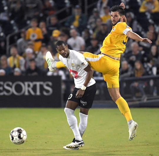 Nashville SC defender Forrest Lasso (33) collides with Charleston Battery's Ataulla Guerra during their quarterfinal playoff match Oct. 26. Nashville faces Indy Eleven on Saturday in the Eastern Conference semifinals.
